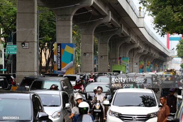 Heavy traffic is seen alongside a light rail transit track in downtown Palembang city in South Sumatra province on June 28 2018 The LRT in the city...