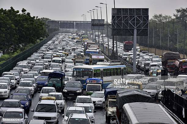 Heavy Traffic jam at NH8 near Shankar Vihar due to rain on July 8 2016 in New Delhi India Rains hit several parts of the national capital which kept...