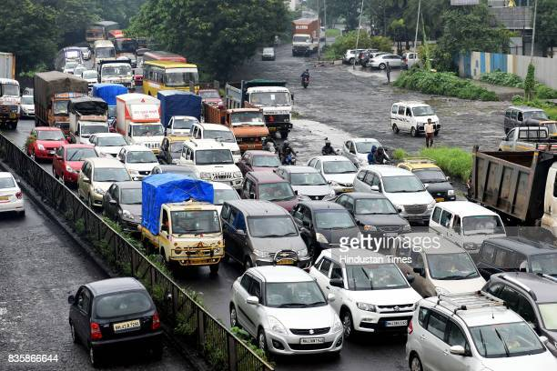 Heavy traffic jam due to bad condition of roads at Sion Panvel near Turbhe during the rain on August 19 2017 in Mumbai India These weather conditions...