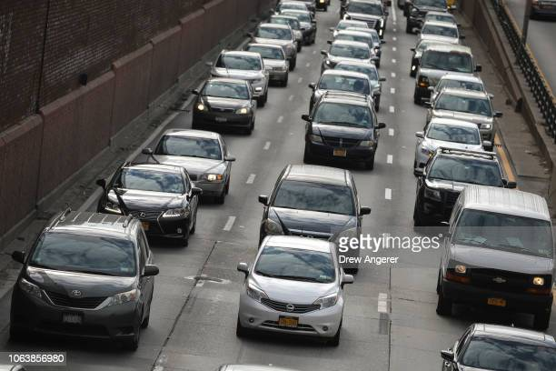 Heavy traffic moves along the BrooklynQueens Expressway November 20 2018 in the Brooklyn borough of New York City The American Automobile Association...