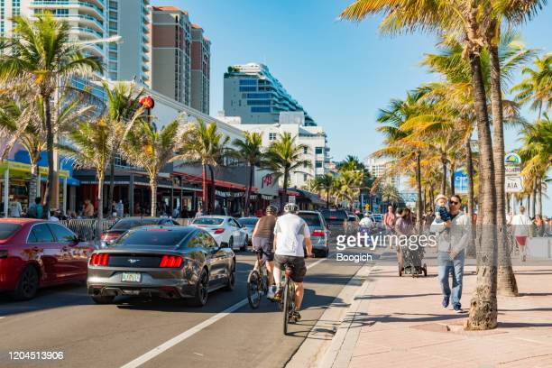 heavy traffic on a1a street in fort lauderdale beach during spring break - fort lauderdale stock pictures, royalty-free photos & images