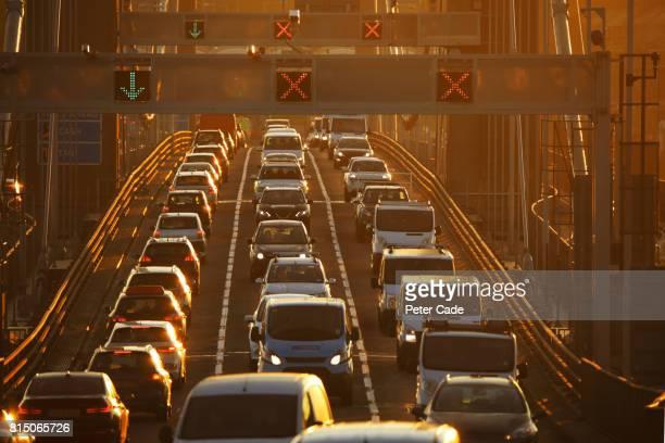 Heavy traffic on bridge at sunset