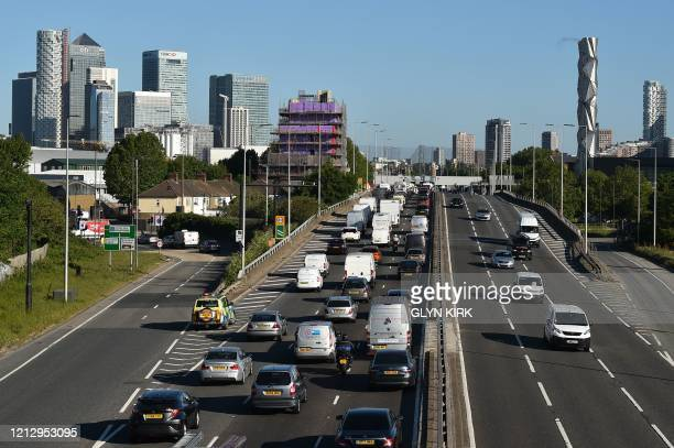 Heavy traffic queues on the approach to enter the Blackwall Tunnel heading north towards central London during the morning rush hour on May 14 2020...