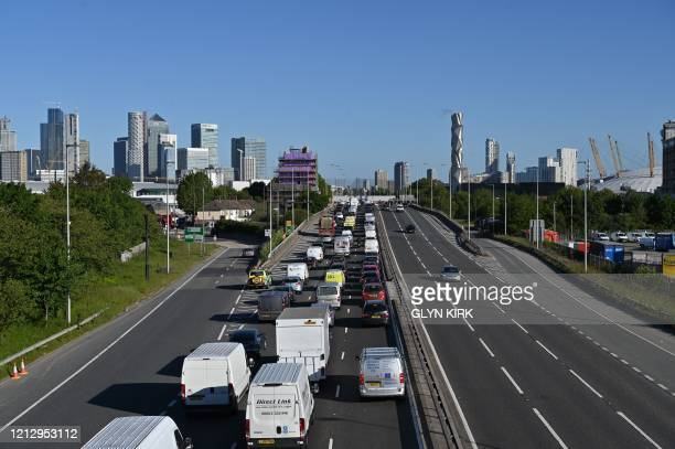 Heavy traffic queues on the approach to enter the Blackwall Tunnel heading north towards central London during the morning rush hour on May 14, 2020...