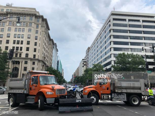 Heavy trucks barricade the streets near the White House as farright activists gather for the Unite the Right rally August 12 2018 in Washington DC on...