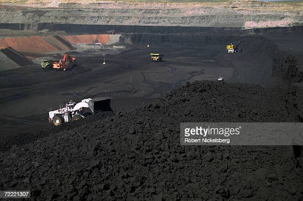 Heavy vehicles move newly blasted coal following a timed detonation at the Buckskin Coal Mine on June 13 2006 in Gillette Wyoming The open pit Powder...