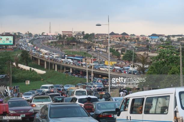 Heavy vehicular traffic along Ibadan-Lagos Expressway on Monday. Commuters and motorists suffered unprecedented traffic jam as angry Nigerian youths,...