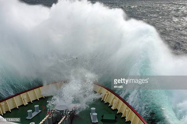 Heavy wave hitting the bow of a ship