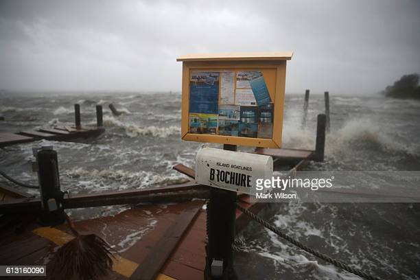 Heavy waves caused by Hurricane Matthew pound the boat docks at the Sunset Bar and Grill October 7 2016 on Cocoa Beach Florida Hurricane Matthew...