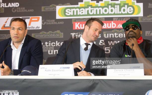 Heavy weight boxers Kubrat Pulev and Dereck Chisora sitting next to boxing promoter Kalle Sauerland during a press conference in Hamburg Germany 3...
