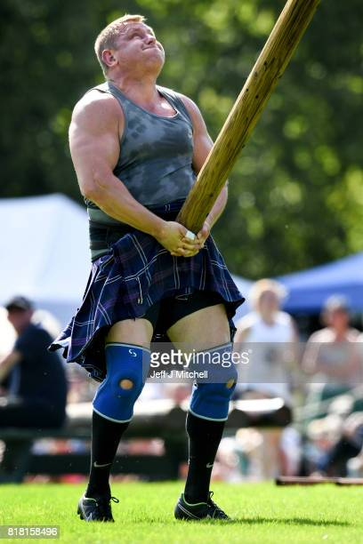 Heavy weight competitors take part in the World Caber Tossing competition at Inveraray Highland Games on July 18 2017 in Inverarary Scotland The...