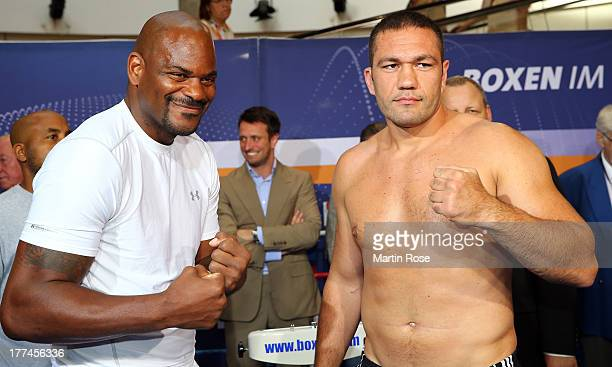 Heavy weight fighter Kubrat Pulev of Bulgaria and Tony Thompson of USA pose during the weigh in at Schloss Park Center on August 23 2013 in Schwerin...