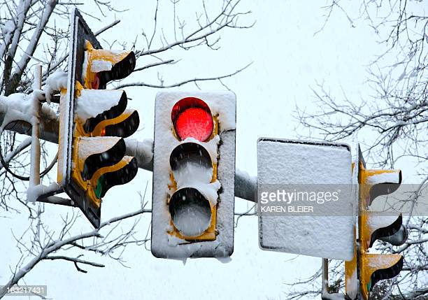 Heavy wet snow covers traffic signals at an intersection March 6 2013 in Prince William County Virginia A winter storm is dumping rain sleet and snow...
