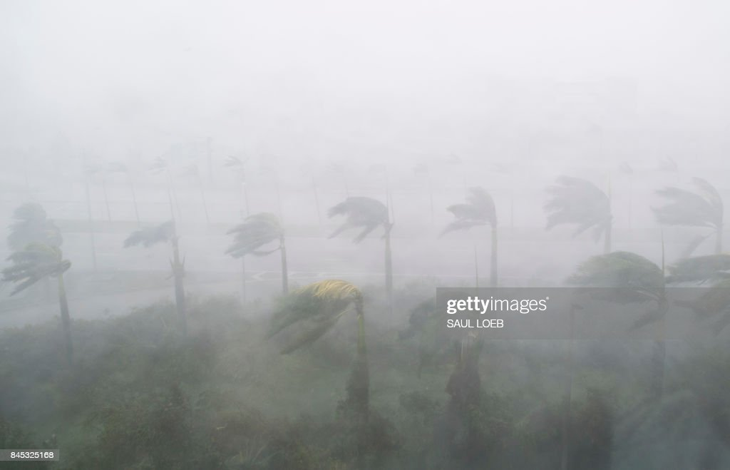 TOPSHOT - Heavy winds and rain from Hurricane Irma are seen in Miami, Florida on September 10, 2017. Hurricane Irma's eyewall slammed into the lower Florida Keys, lashing the island chain with fearsome wind gusts, the US National Hurricane Center said. /