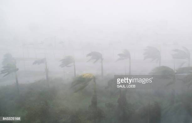 TOPSHOT Heavy winds and rain from Hurricane Irma are seen in Miami Florida on September 10 2017 Hurricane Irma's eyewall slammed into the lower...