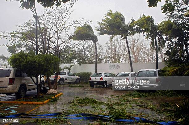 Heavy winds lash the parking of a hotel in Chetumal City Mexico during Category 5 hurricane Dean lashing 21 August 2007 Mexican authorities on Monday...