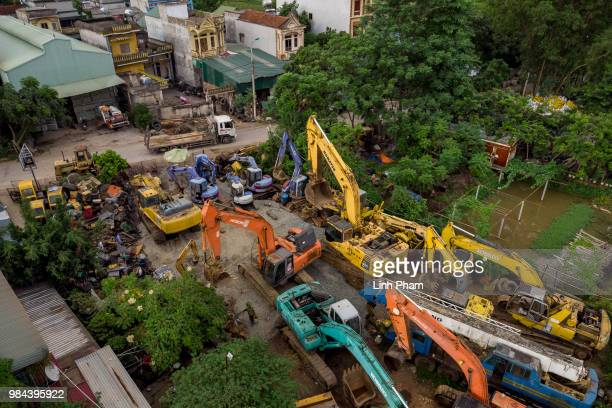 A heavyduty vehicle scrapyard located on the main road of Te Lo village can be seen from an aerial shot on June 25 2018 in Te Lo Village Yen Lac...