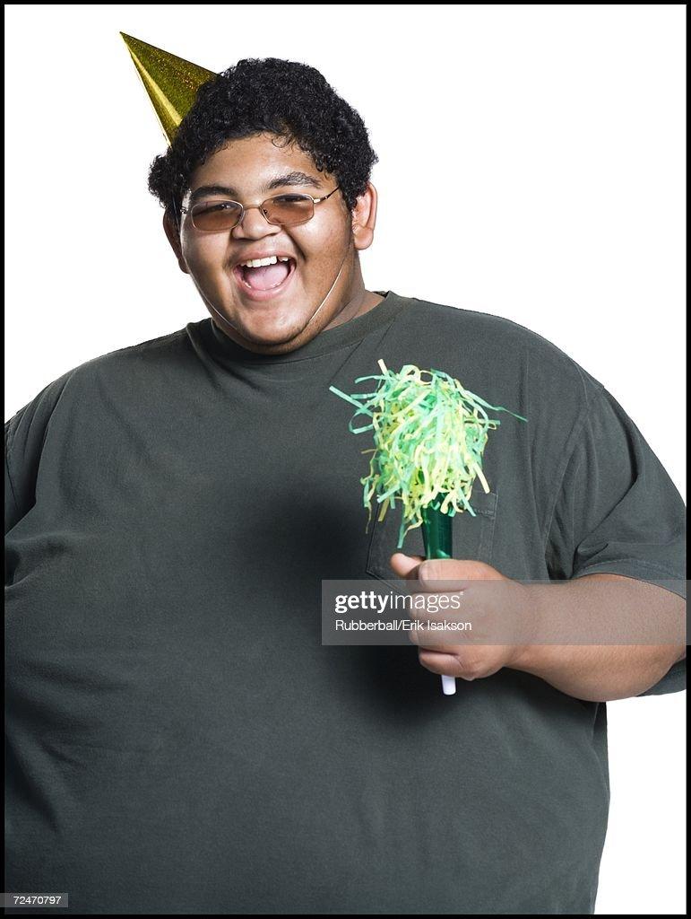Heavyset young man celebrating birthday : Stock Photo
