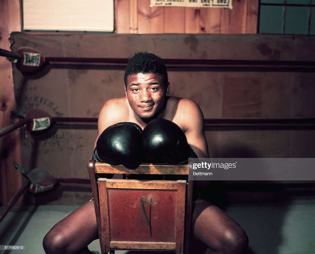 Heavyweight boxer Floyd Patterson sitting in a chair.
