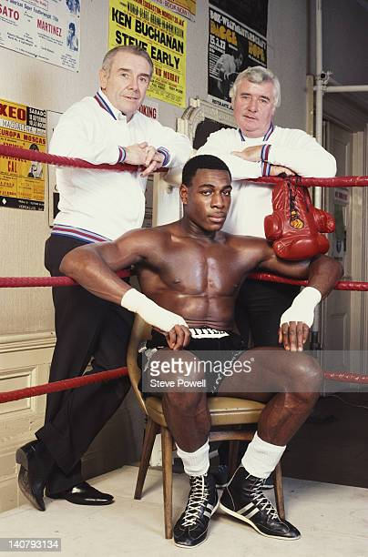 Heavyweight boxer Frank Bruno sits on a stool in the training ring between his trainers Terry Lawless and Frank Black on 1st September 1983 at the...