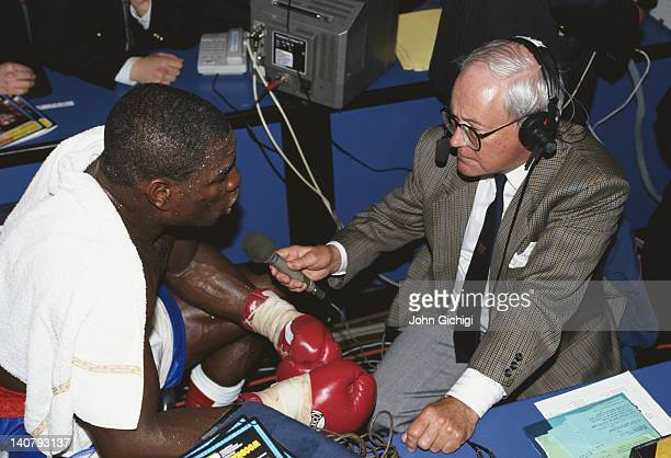 Heavyweight boxer Frank Bruno talks to television commentator Harry Carpenter on 20th November 1991 at the Royal Albert Hall in London Great Britain