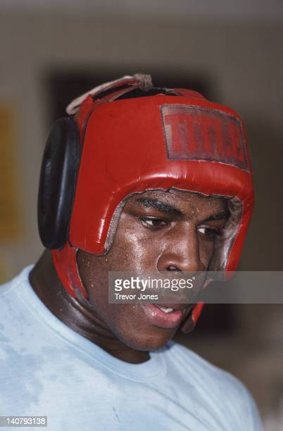 Heavyweight boxer Frank Bruno with a head guard on during training on 1st September 1983 at the Royal Oak gym in Canning Town London Great Britain