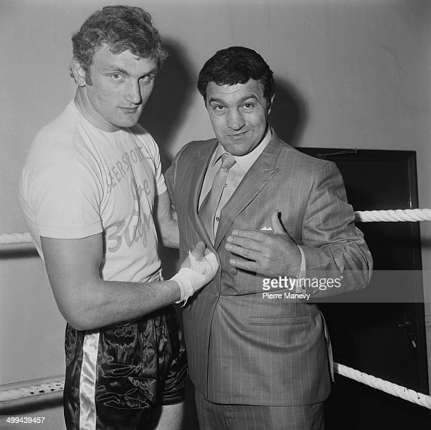 Heavyweight boxer Joe Bugner with American former World Heavyweight Champion Rocky Marciano at a gym in North London 4th May 1969