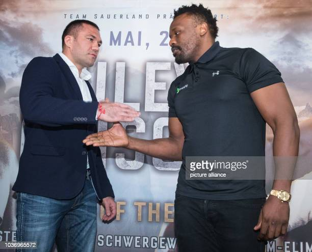 Heavyweight boxer Kubrat Pulev of Bulgaria shakes hands with Dereck Chisora of Britain following a press conference with boxing promoter Kalle...