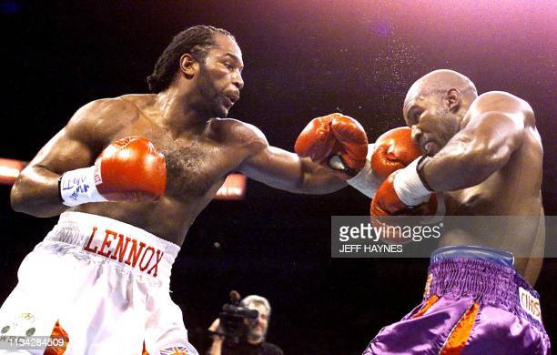 Heavyweight boxer Lennox Lewis frm Great Britain lands a left against Evander Holyfield of the USA during fourth round action at the Thomas Mack...
