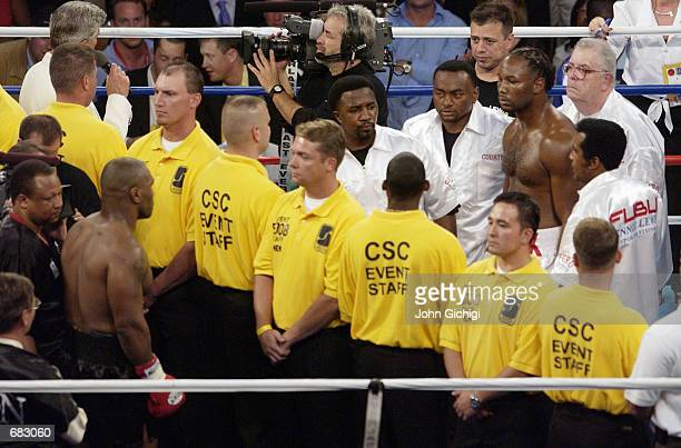 Heavyweight boxer Lennox Lewis staresdown Mike Tyson while blocked by security guards before the start of the WBC/IBF heavyweight championship bout...