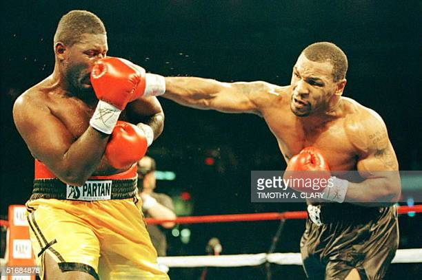 Heavyweight boxer Mike Tyson lands a punch to the nose of opponent Buster Mathis Jr during the second round just before knocking him out in the third...
