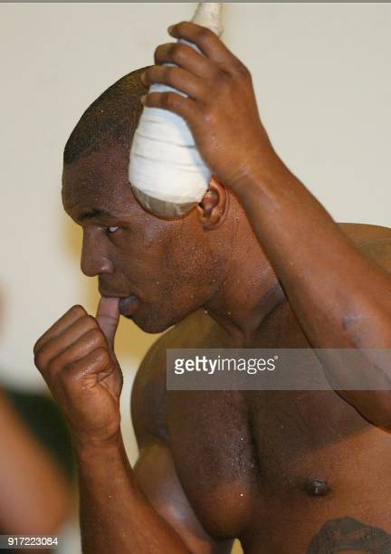 Heavyweight boxer Mike Tyson sticks his thumb in his mouth as he holds a dodging bag during a workout at the Fitzgerald Casino in Tunica Mississippi...