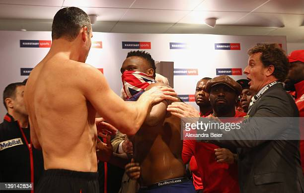 Heavyweight boxer Vitali Klitschko of Ukraine reacts after he received a slap in the face by Dereck Chisora of the UK during the weigh in for their...
