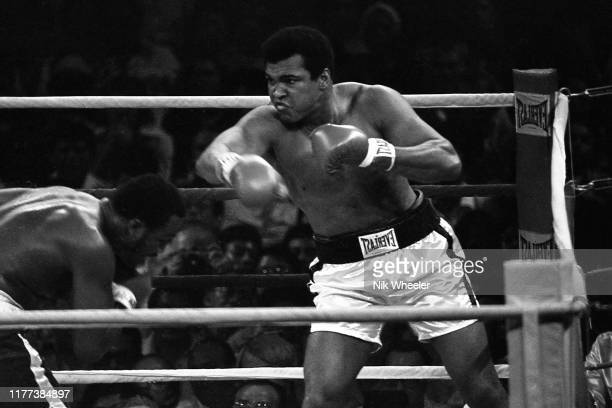 Heavyweight boxers Muhammad Ali and Joe Frazier fight in the ring during their world championship bout in Manila in September 1975