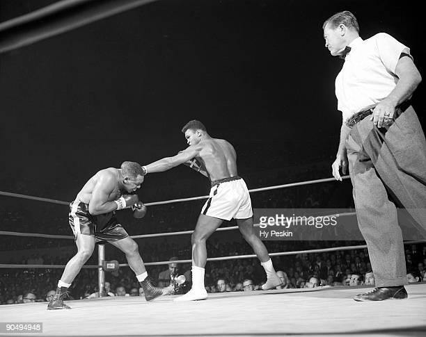 Cassius Clay in action vs Archie Moore during fight at Sports Arena Los Angeles CA CREDIT Hy Peskin
