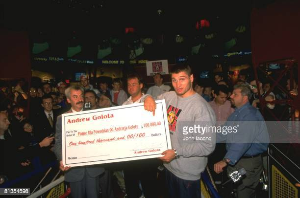 Heavyweight Boxing Casual portrait of Andrew Golota with enlarged check for $100000 for Flood Victims Support at All Star Cafe View of fans New York...