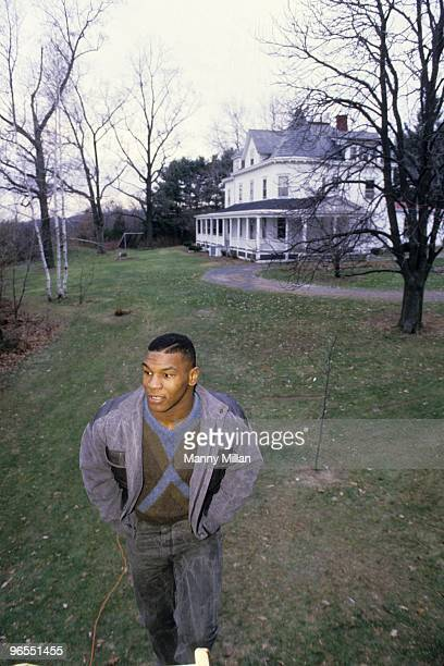 Casual portrait of Mike Tyson outside of the home of his surrogate mother Camille Ewald. Catskill, NY 12/1/1985 CREDIT: Manny Millan