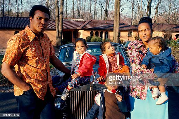 Heavyweight Boxing Casual portrait of Muhammad Ali with family twin daughters Jamillah and Rasheda daughter Maryum and wife Khalilah holding son Ibn...