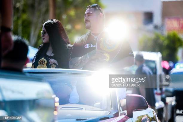 Heavyweight boxing champion Andy Ruiz Jr and his wife Julie Ruiz wave to supporters during a parade in his honor on Saturday June 22 2019 in Imperial...