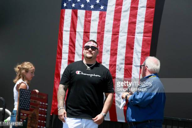 Heavyweight boxing champion Andy Ruiz Jr stands onstage during a homecoming parade on June 22 2019 in Imperial California Boxer Andy Ruiz upended...