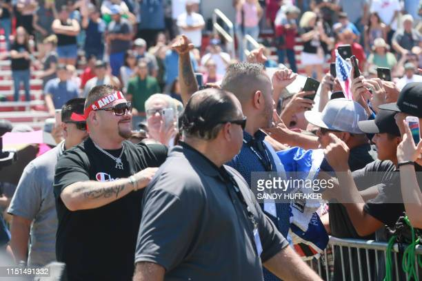 Heavyweight boxing champion Andy Ruiz Jr waves to supporters during a homecoming parade on June 22 2019 in Imperial California Boxer Andy Ruiz...