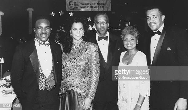 Heavyweight boxing champion Evander Holyfield and actress Jayne Kennedy-Overton at a United Negro College Fund event, 1980.