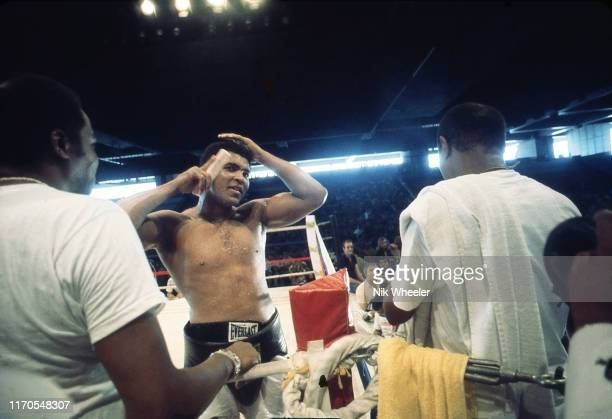 Heavyweight boxing champion Muhammad Ali combs his hair in jest before a sparring bout in the Manila Convention Center in preparation for his...