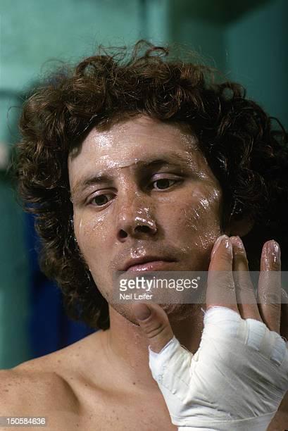 Closeup portrait of Duane Bobick applying vaseline onto face in locker room before fight vs Donnie Nelson at Denver Coliseum Denver CO CREDIT Neil...