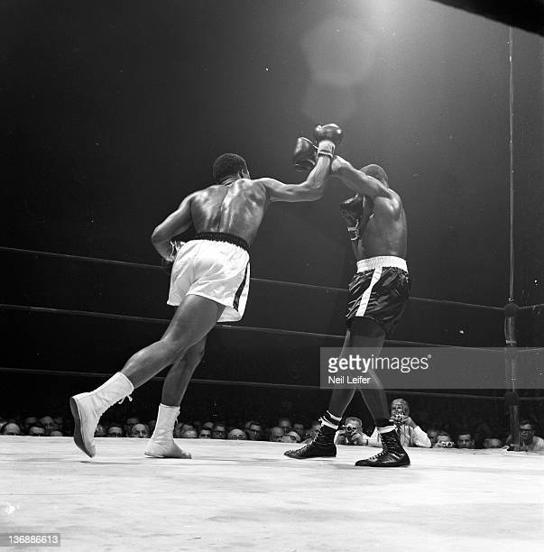 Heavyweight Boxing Doug Jones in action blocking punch by Muhammad Ali during fight at Madison Square Garden New York NY 3/13/1963 CREDIT Neil Leifer