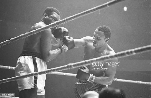 Heavyweight Boxing Joe Frazier in action throwing punch vs Doug Jones at The Arena Philadelphia PA 2/21/1967