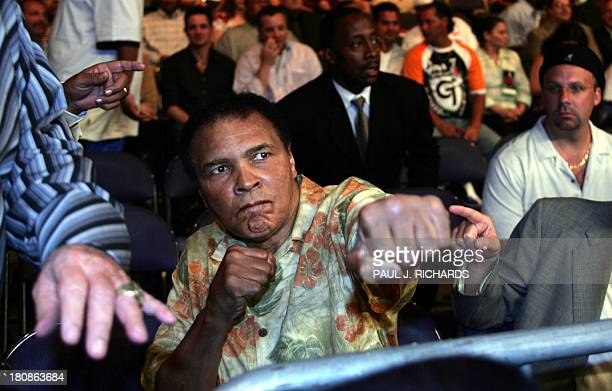 Heavyweight boxing legend Muhammad Ali arrives at ringside with clenched fists 11 June 2005 at the MCI Center in Washington DC where Ali's daughter...