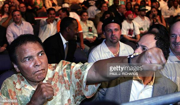 Heavyweight boxing legend Muhammad Ali arrives at ringside with fists clenched 11 June 2005 at the MCI Center in Washington DC where Ali's daughter...