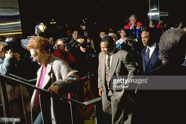 Mike Tyson and his surrogate mother, Camille Ewald arriving at City-County Building courthouse during his trial regarding rape charges. Indianapolis,...