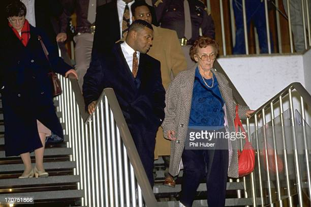 Mike Tyson and his surrogate mother, Camille Ewald leaving City-County Building courthouse during his trial regarding rape charges. Indianapolis, IN...